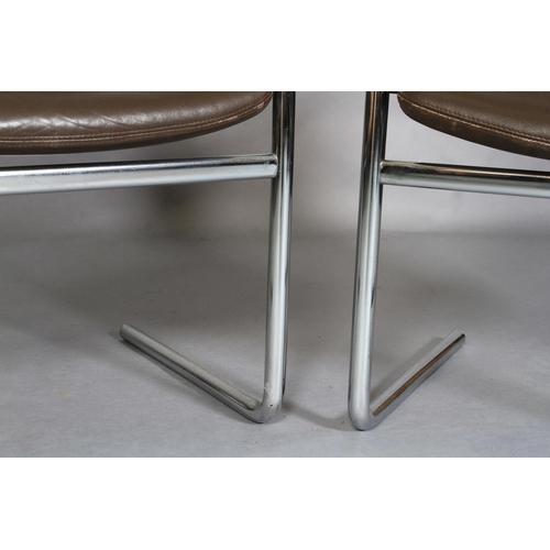 52 - A pair of brown leather and chrome cantilever chairs, c.1970s, horizontally stitched panel back and ...