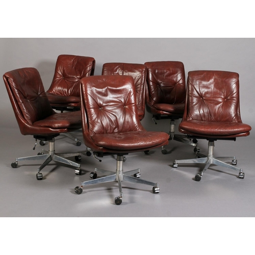 55 - Andre Vandenbeuck for Strassle International c.1960s, a pair of Gentilina buttoned leather swivel ch...