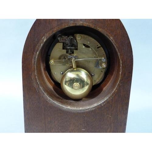 18 - A Comitti mahogany cased mantel clock of lancet shape, 27cm high...