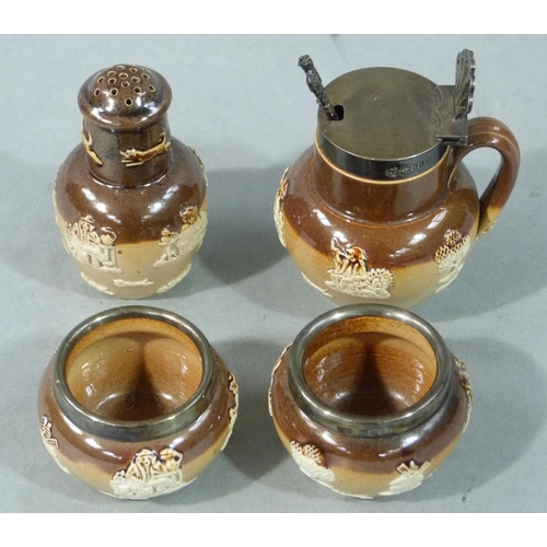 25 - A four piece Doulton Lambeth saltglaze cruet mounted in silver and sprigged with hunting scenes, imp...