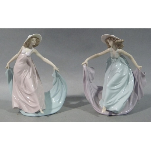 35 - Two Lladro figures of young ladies in sunhats, long gowns and shawls in pastel colours, 23cm high (o...