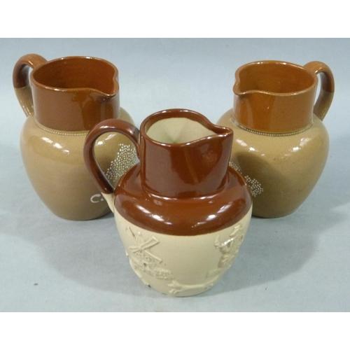 38 - Three Bourne Denby stoneware jugs including two Cadbury advertising jugs...