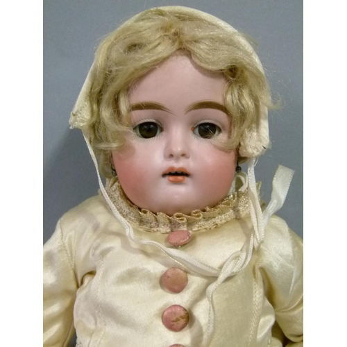 47 - A Bru style doll with bisque head and composition jointed body, sleeping eyes, open mouth with teeth...