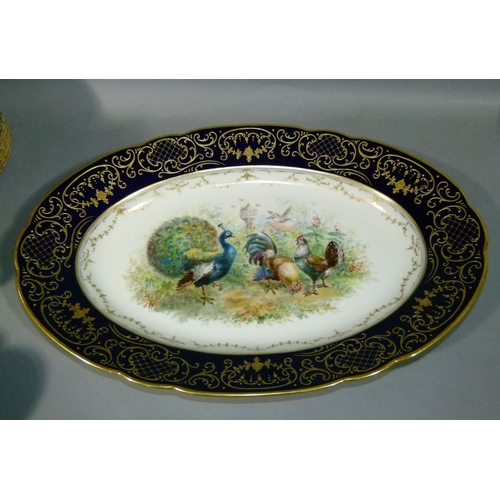 29 - A Dresden porcelain oval meat platter, the centre painted with chickens, cockerel and peacock with d...