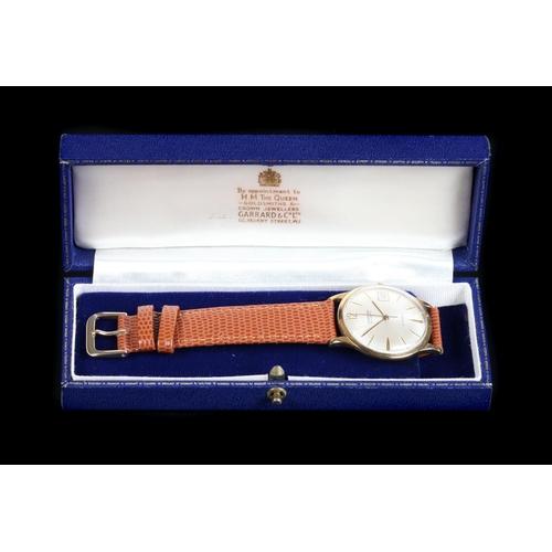 59 - A Garrard gentleman's 9ct gold wristwatch c.1965, automatic, 21 jewel lever movement, silvered sunbu...