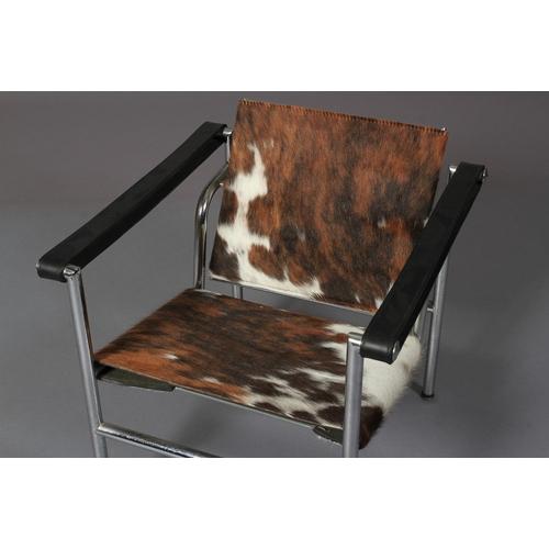 15 - LCI Armchair Le Corbusier style,  chrome tubular framed open armchair, leather arms, cowhide seat an...