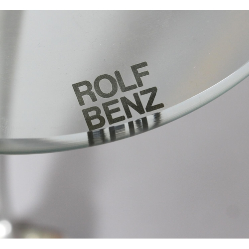 16 - Rolf Benz - a glass and brushed aluminium coffee table, rounded triangular form on swept legs and ca...