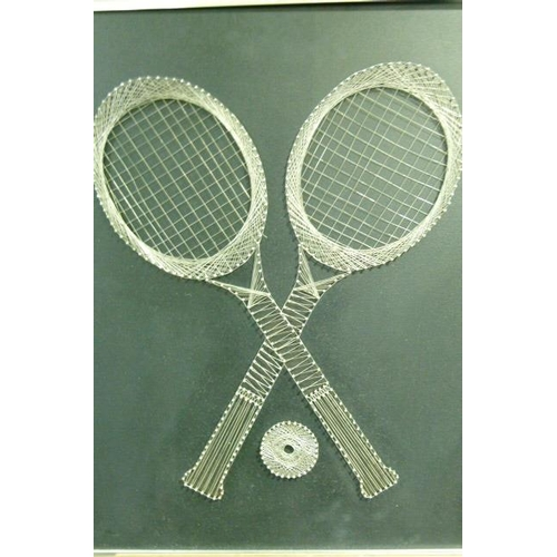 21 - A pin and wire picture of crossed tennis racquets and ball on a black ground, c.1970s,  72cm x 63cm...