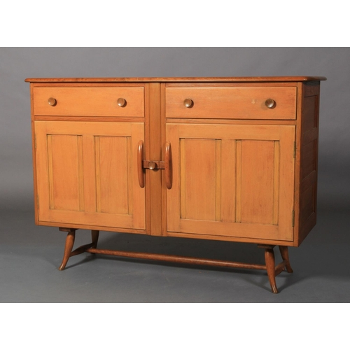 32 - Ercol, a pale elm sideboard, c.1955/60 two frieze drawers above two twin indented panel cupboard doo...