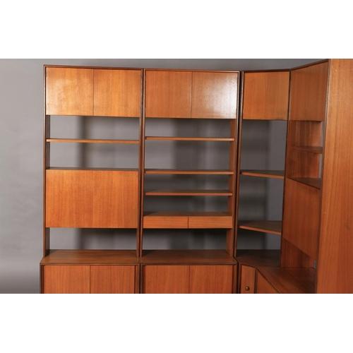 34 - G Plan, a teak combination wall unit c.1970s comprising, two two door base units, 76.5cm wide, a dou...