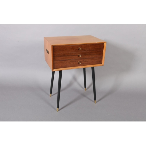 36 - A teak three drawer chest canteen c.1950's on ebonised rounded legs, containing an extensive suite o...