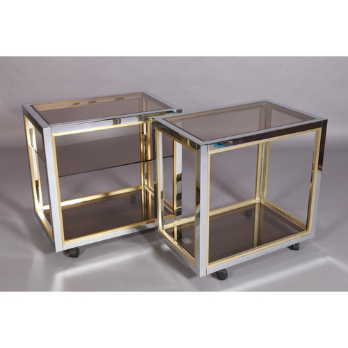 4 - A pair of vintage brass and chromium plated drinks trolleys with smoked glass shelves, one with midd...