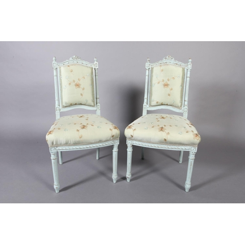 43 - A pair of French style pale blue single chairs, the arched top rail with carved ribbon cresting, sil...