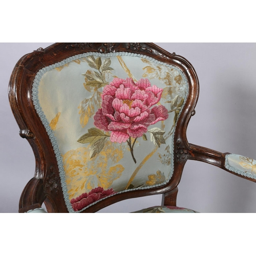 44 - A French fauteuil style open armchair, encircling frame and floral upholstered back and seat, on cab...