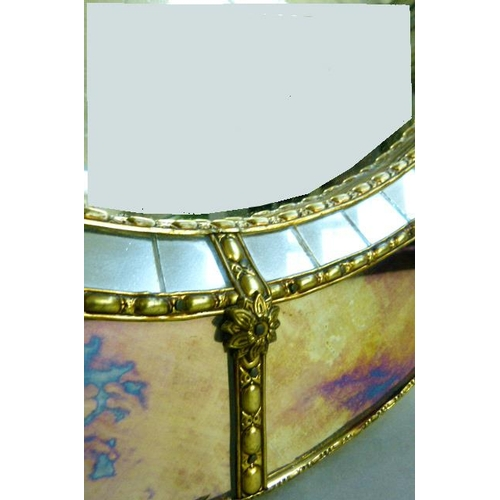 45 - An oval wall mirror with raised mirror-panelled and gilt metal beaded surround, 82cm x 63cm