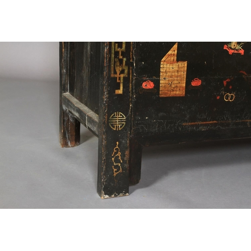 46 - A Chinoiserie ebonised cabinet having two doors above a panel decorated with archaic symbols, the in...