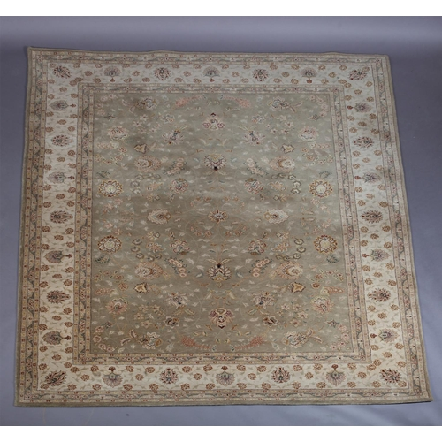 49 - A Zeigler style carpet in pale olive within an ivory main border, 261cm x 351cm...