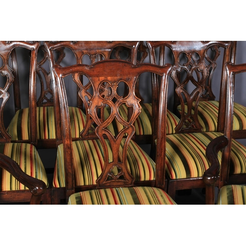 52 - A set of ten hardwood dining chairs of mid 18th century design, having a striped velvet and flat wea...