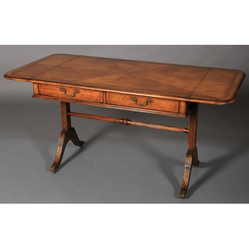 55 - A cherrywood sofa table of 18th century style crossbanded and strung with radiating veneers, twin dr...