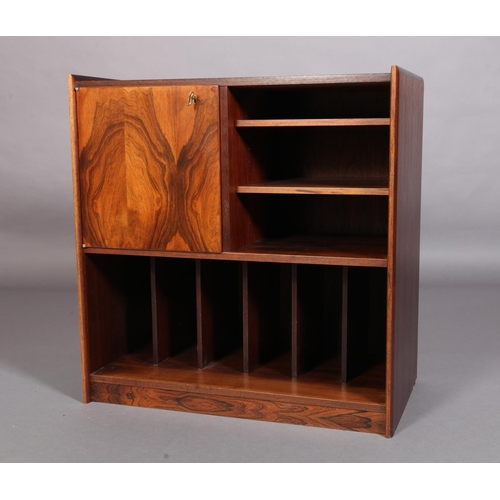 9 - A rosewood veneered audio cabinet, the top above a single door cupboard, flanked by adjustable shelv...