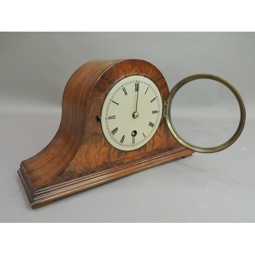 15 - A walnut veneered arched mantle clock circa 1930's the figured front with hinged brass bezel enclosi...