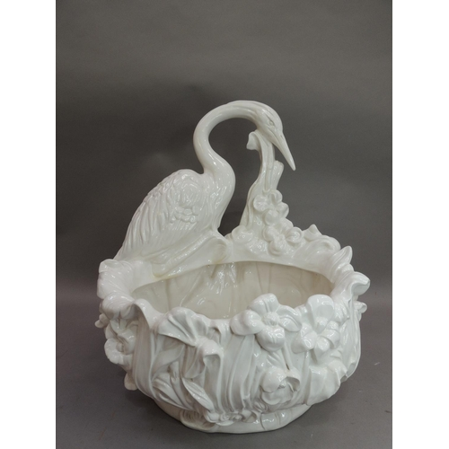 20 - An Italian white pottery planter modelled as a floral and leaf moulded oval bowl with crane to the r...