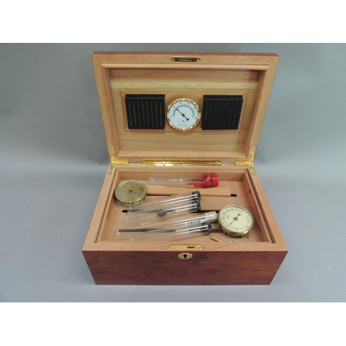 23 - A modern cigar humidor in burr ash inlaid to the hinged top with a parquetry border, pair of gilt br...
