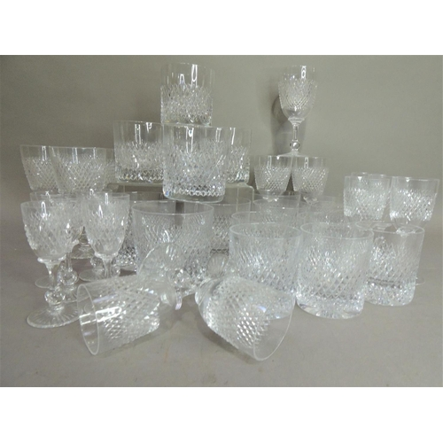 24 - A good Halcyon Days blue diamond suite of glassware circa 1962 comprising six wine glasses, six sher...
