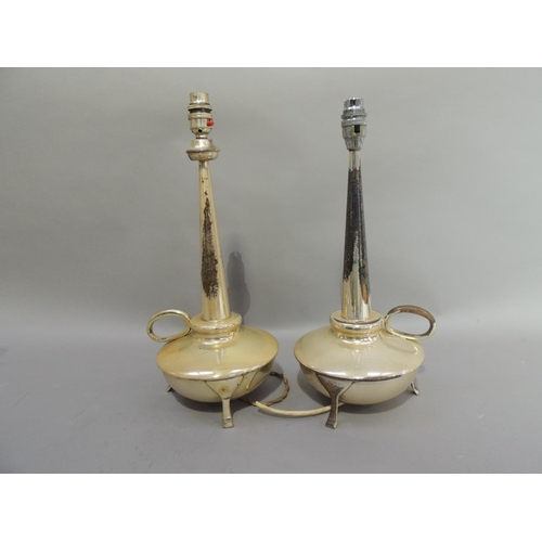 26 - A pair of silver plated lamps with tapered columns and circular reservoirs with loop handle and thre...