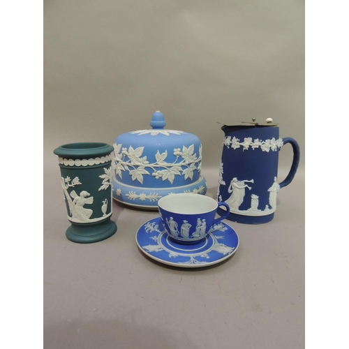27 - A Wedgwood blue jasper dip, cup and saucer detailed in relief with alternately applied trees and cla...