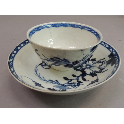 3 - A Liverpool tea bowl and saucer, 18th century painted in underglaze blue with flowers and leafage wi...