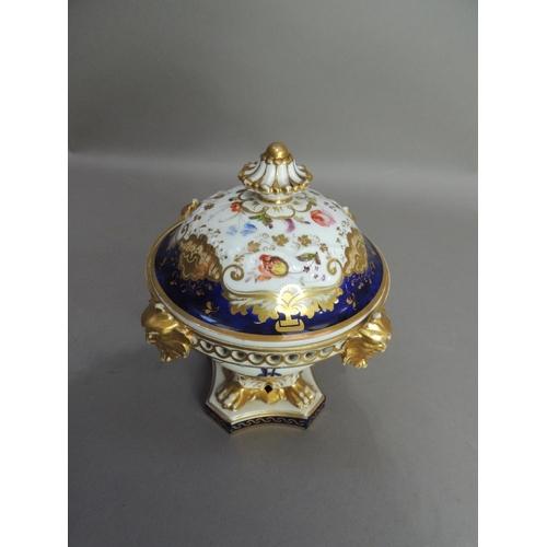 30 - A Derby porcelain pot pourri vase, the guilloche pierced rim set with four grotesque masks above an ...