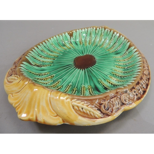 36 - A Victorian majolica dish of two handled oval form, the centre with corn stooks, the border moulded ...