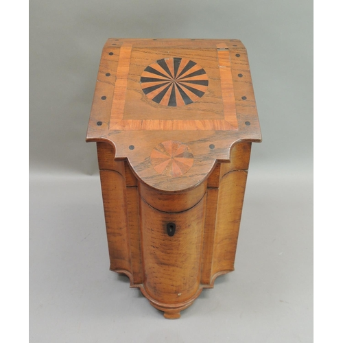 40 - An oak slope top cutlery box the hinged lid with circular segmental panel within satinwood border an...