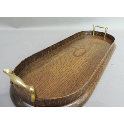 42 - A two handled oak tray of oval ended rectangular form, the centre inlaid with a shaded shell paterae...