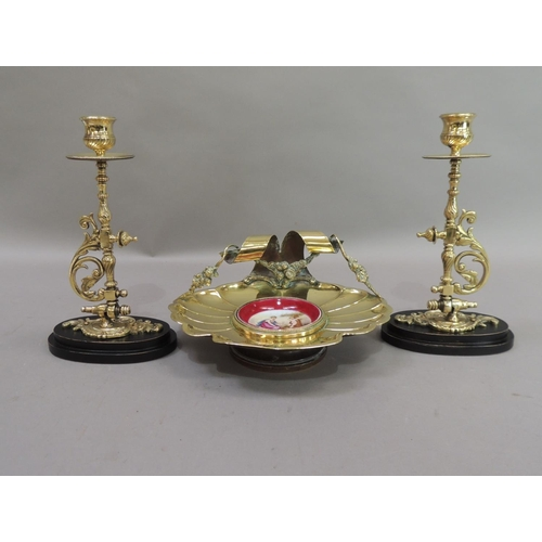 44 - A late 19th century brass dish of fluted shell form, the back with ribbon and garland carrying handl...