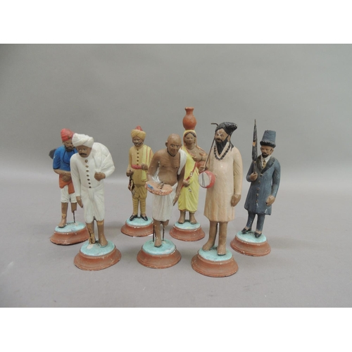 46 - A set of seven painted plaster figures of Indian peasants and aristocrats, circular bases, 12cm high...
