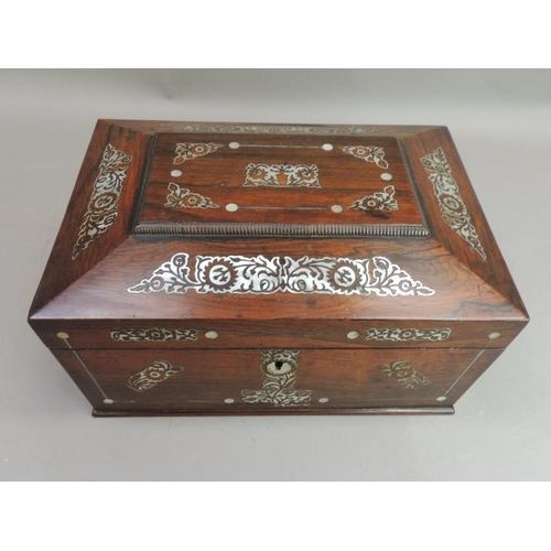 5 - A late Regency rosewood and mother of pearl inlaid work box of sarcophagus shape, with side brass ro...