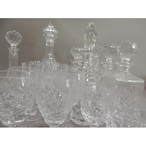 53 - Three Edinburgh cut glass decanters and stoppers, square form, 27cm high approximately; together wit...