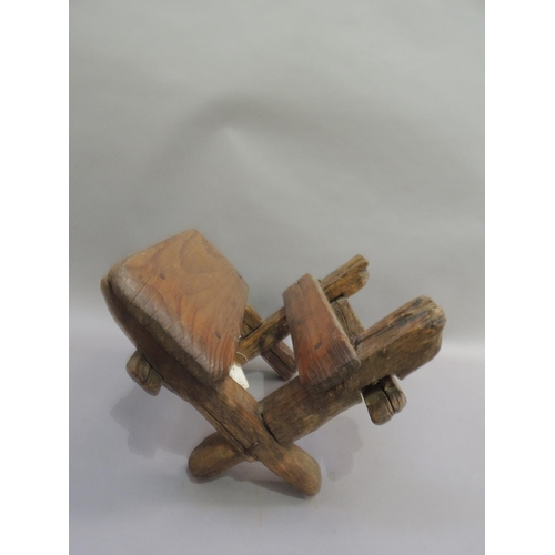 56 - Gold Rush Interest - a wooden mule saddle, 36cm wide, 23cm high approx