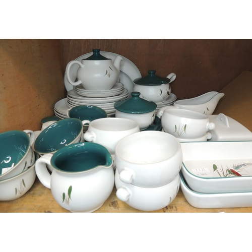 59 - A quantity of Denby dinner and breakfast ware including teapots, lidded tureens, soup bowls, cups, s...