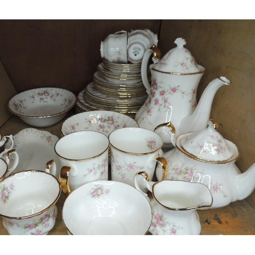60 - A Royal Albert Victoriana Rose tea service comprising plates, cups, saucers, bowls, mugs, teapot, co...