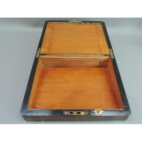 9 - A Victorian brass bound burr walnut veneered writing slope the hinged top with vacant rectangular ca...