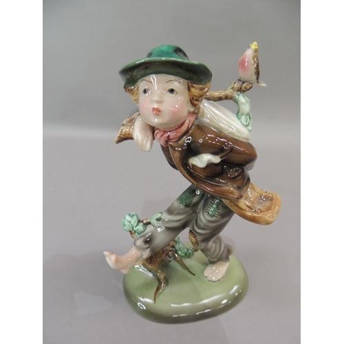 4 - A Royal Vienna figure of a boy with knapsack