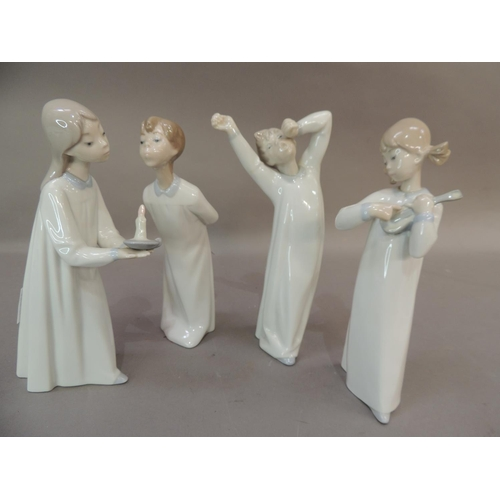 49 - Four Lladro porcelain figures of young children in their night clothes, 21cm high and smaller