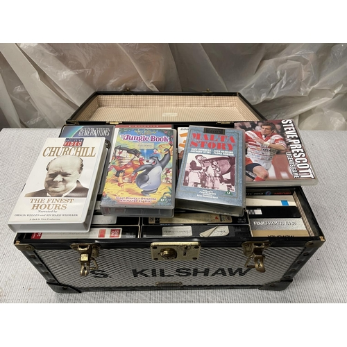 130 - METAL STORAGE TRUNK FULL OF VIDEO CASSETTES & DVDS (12