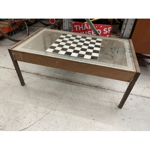176 - GLASS TOPPED TABLE