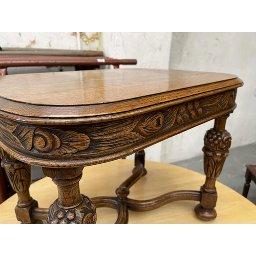 179 - SMALL ORNATELY CARVED TABLE - 19