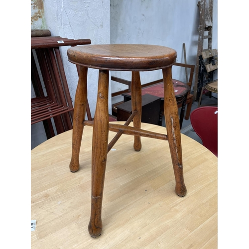 216 - WOODEN MILKING STOOL WITH AGE 21