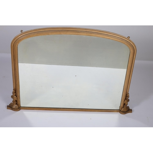 11 - A 19TH CENTURY GILTWOOD OVERMANTEL MIRROR the rectangular arched plate within a moulded frame with a...
